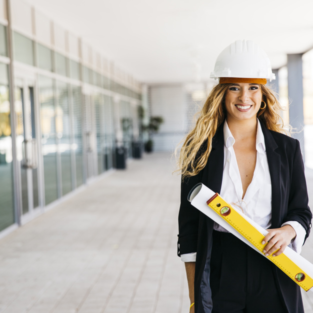smiling-female-architect-with-helmet_23-2147702529